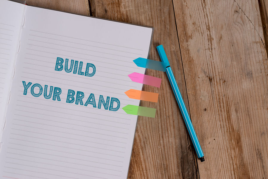 Build your brand written on lined paper