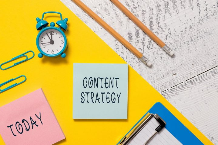 Picture of content strategy written on a post it note against stationary on an SEO consultants desk