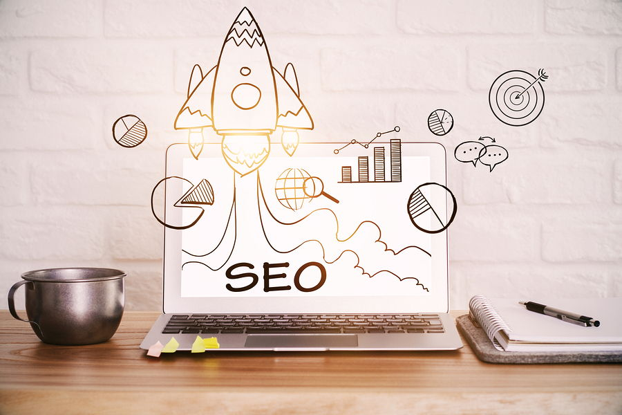 Picture of a rocket jetting off from a page of SEO terms to signify the boost hiring an SEO consultant will bring to your business