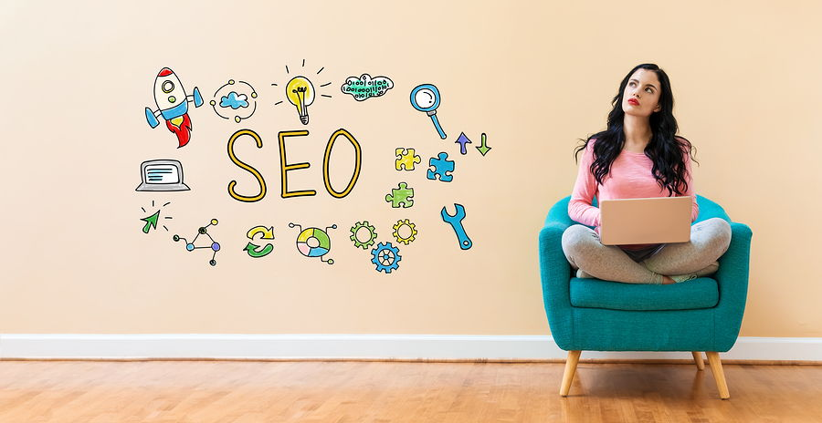 Picture of a female seo consultant in a chair with a thought bubble of SEO terms around her